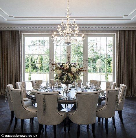 A round table can be so intimate. I love this entire dining room, complete with seating for 12.