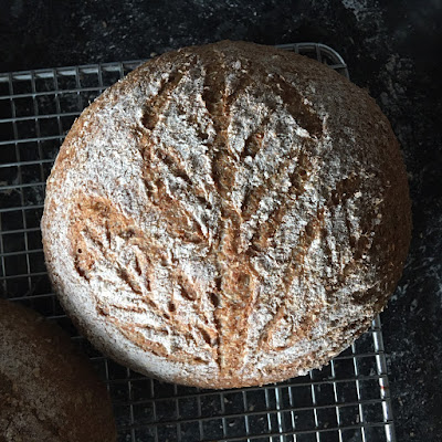 Bread scored with a leafy pattern