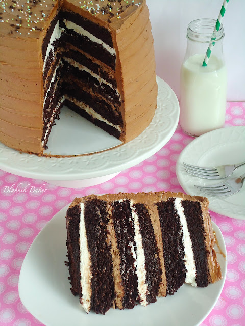 Toasted marshmallow filled chocolate layer cake has six layers of heavenly, decadent, moist chocolate cake! Filled with a toasted marshmallow buttercream frosting and topped with malted chocolate frosting, this is an extraordinary cake for special occasions.