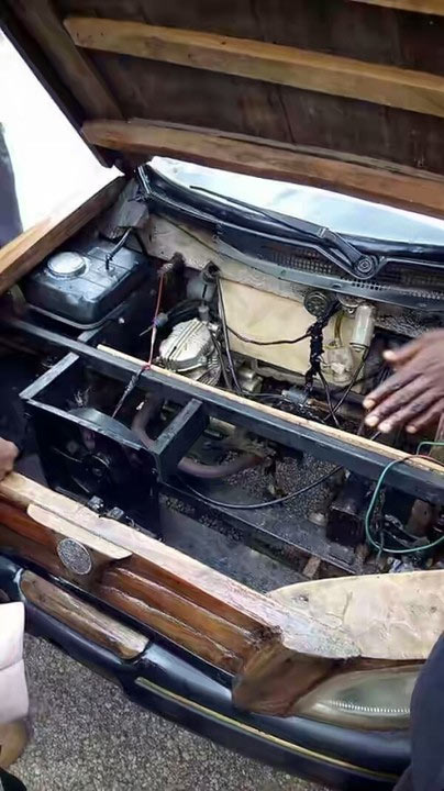 Man drives into Abuja 2016 Expo in his self-made wooden car