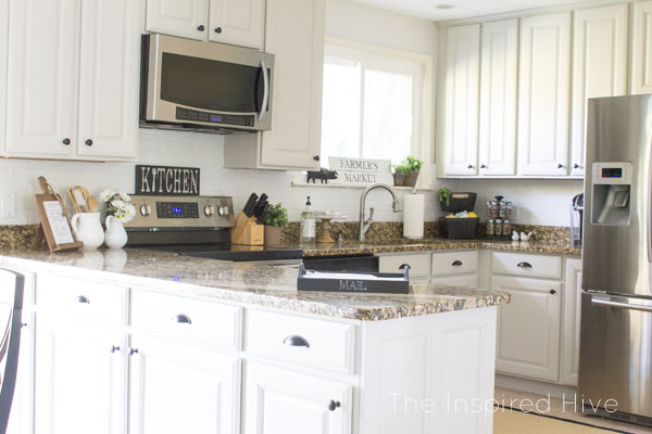 Grey painted cabinets with black hardware