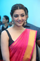Kajal Aggarwal in Red Saree Sleeveless Black Blouse Choli at Santosham awards 2017 curtain raiser press meet 02.08.2017 018.JPG