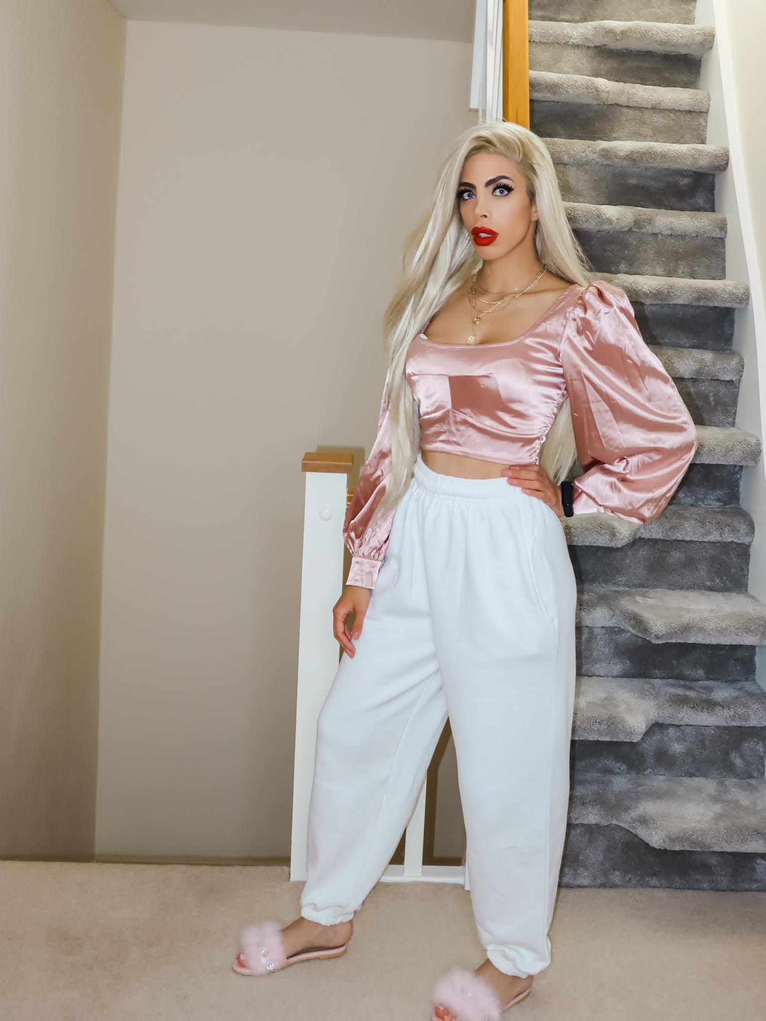 The Femme Luxe White Cuffed Joggers in model Lizzie