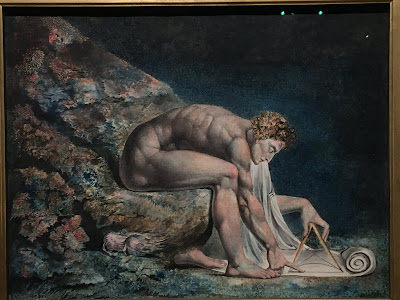Blake painting of a naked man using a pair of compasses on a scroll