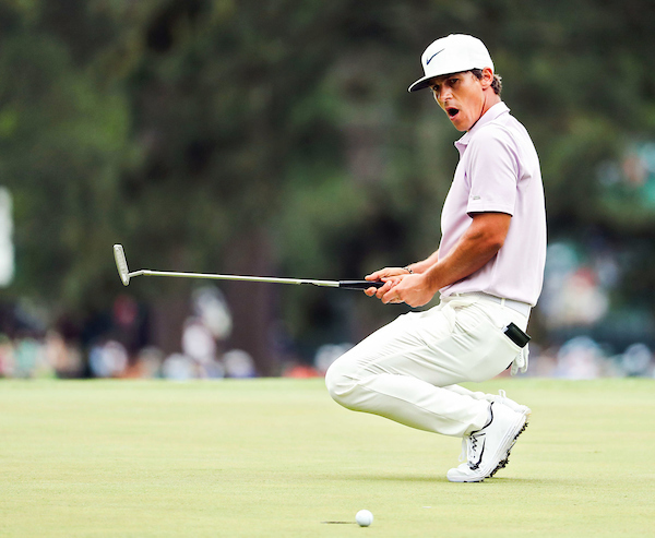 Golfer reacts to missed putt