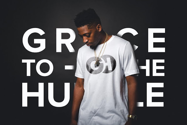 Image of Grace to the humbles classic white tee with their logo around the back