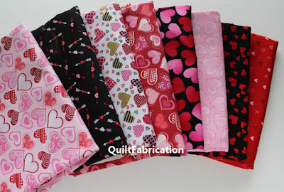 lots of pink and black heart themed fabrics
