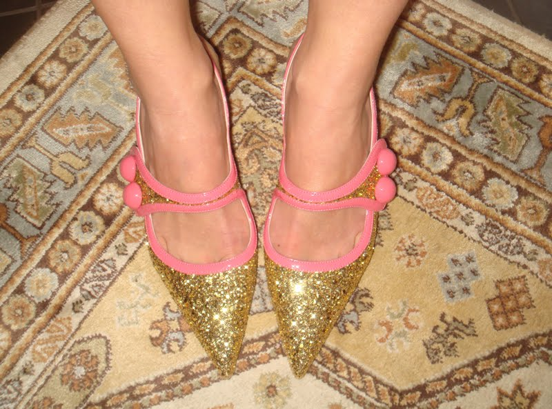 Up close of the gold glitter shoes with pink patent trim.