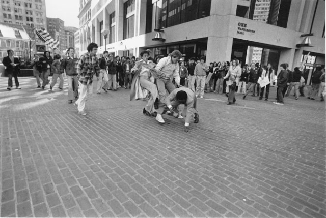 Photo of Ted Landsmark a 29-year-old, Yale-educated lawyer and civil rights activist being thrown to the ground by integration protestors. Photo by Stanley Forman in 1976