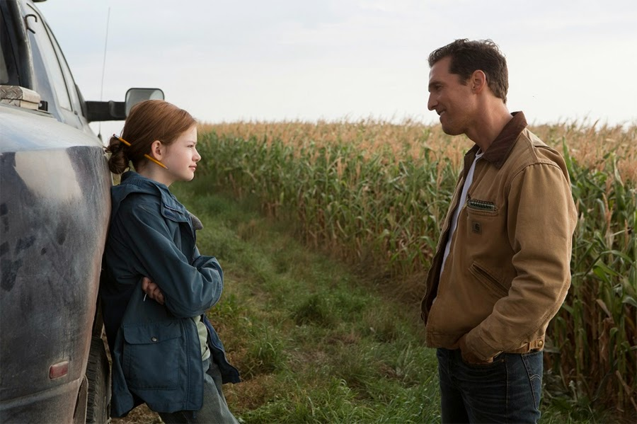 Cooper (played by Matthew McConaughey) with daughter Murph, in Interstellar, Directed by Christopher Nolan