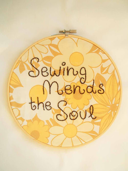 hand embroidered wall art hoop featuring sewing mends the soul quote on vintage fabric