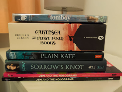 Earthsea: The First Four Books omnibus edition, Sorrow's Know and Plain Kate by Erin Bow, Jem and the Holograms volumes 2 and 3