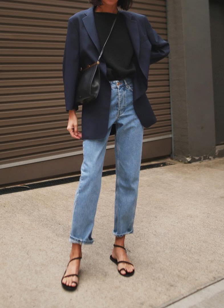 Petra Mack @pepamack Instagram outfit inspiration — navy blue blazer, black t-shirt, high-waisted jeans, and black strappy flat sandals