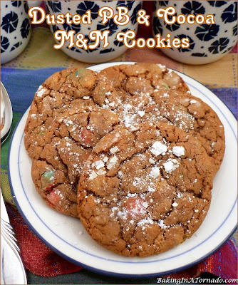 Dusted PB & Cocoa M&M Cookies start with a mix and go from there adding flavor, crunch, and topped with powdered sugar. | Recipe developed by www.BakingInATornado.com | #recipe #cookies