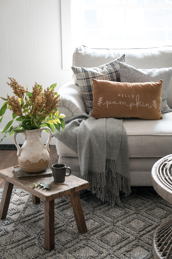 Be inspired for decorating your own modern farmhouse living room for fall with this neutral space.