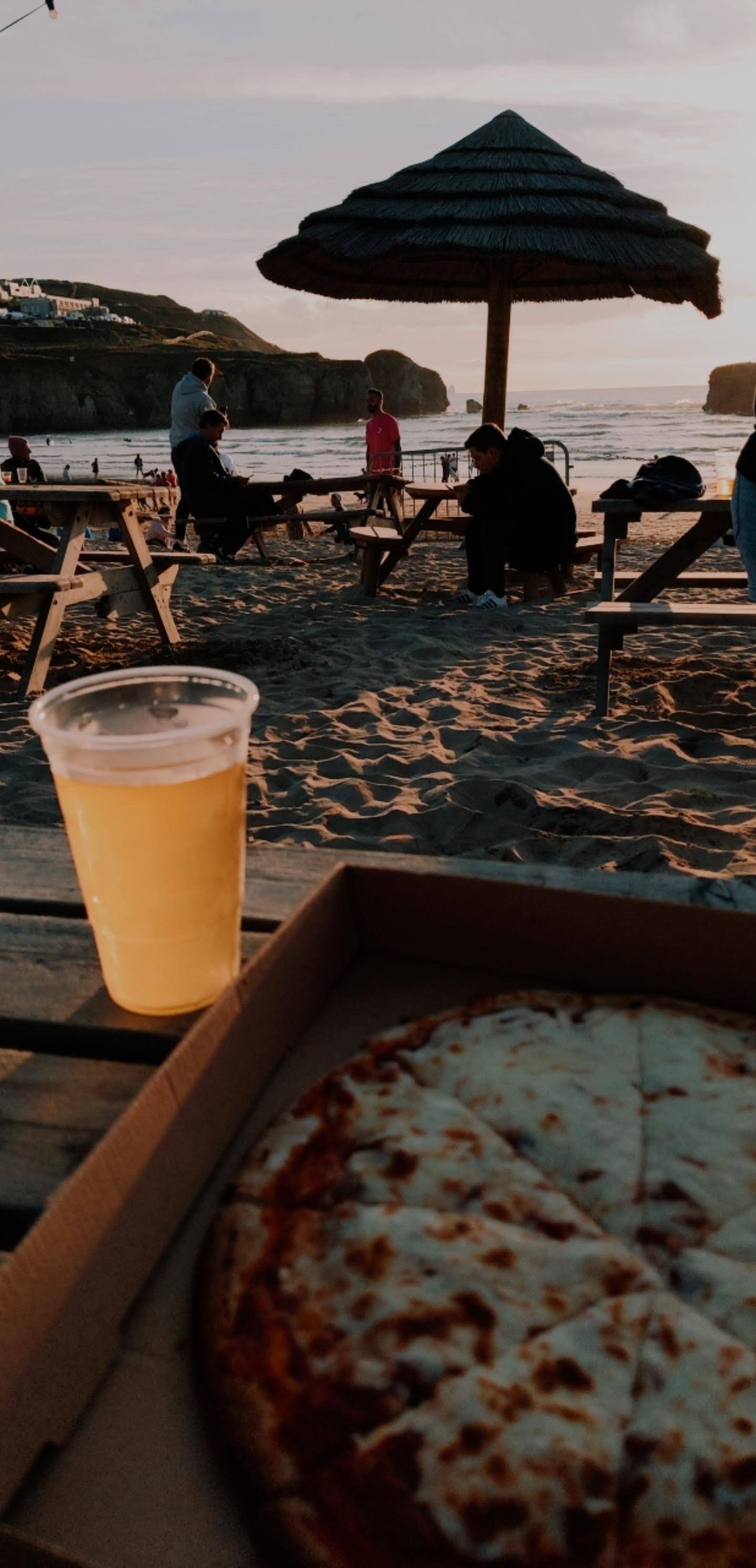Pizza and beer on the beach
