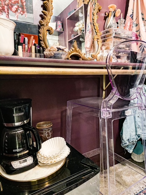 fridge and coffee maker in walk in closet