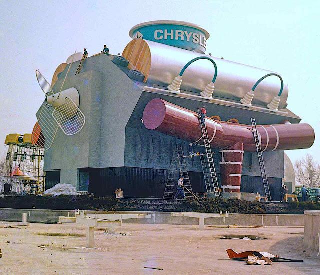 the 1964 World's Fair Chrysler exhibit under construction, a color photograph of a giant car engine