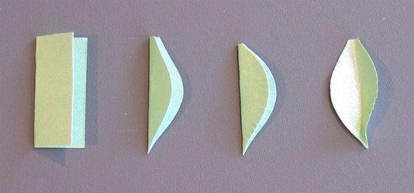 four steps of making a fringed edge folded paper leaf