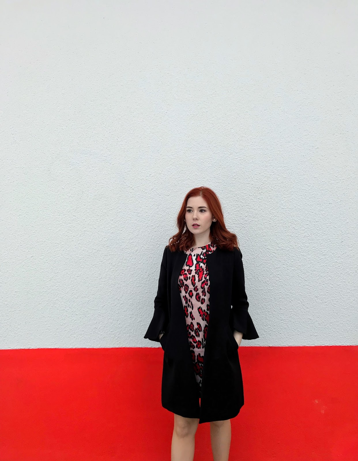 Redhead blogger in red leopard dress