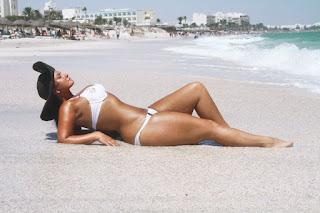 Julia Lavrova Taking Sun Bath At Beach