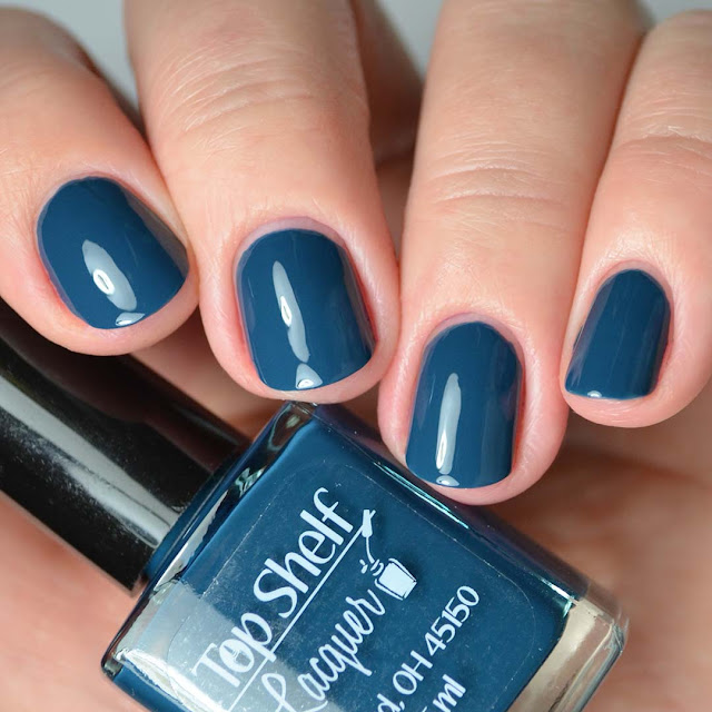 blue nail polish four finger swatch