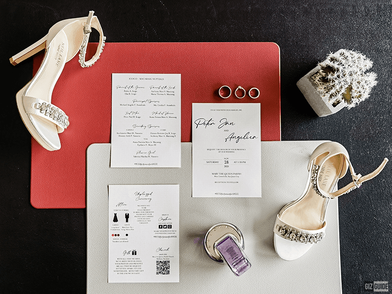Shot of Angel's shoes, perfume, our rings, and wedding invite