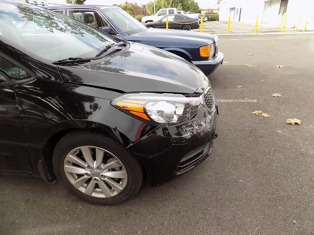 2015 Kia Forte before collision repair at Almost Everything Auto Body.