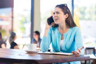 Frustrated woman on the phone