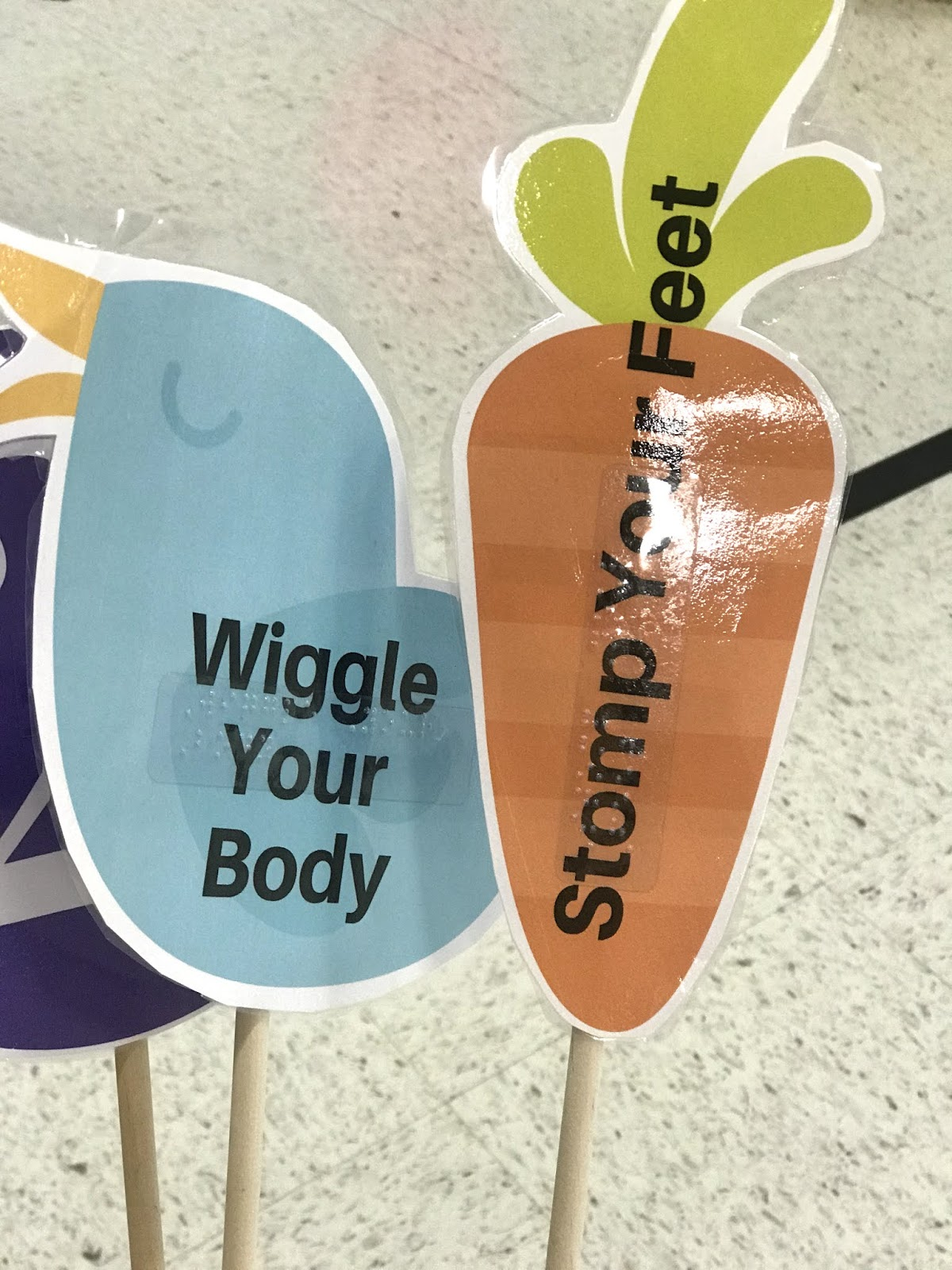 """a close up of the motor activities """"wiggle your body"""" and """"stomp your feet"""""""