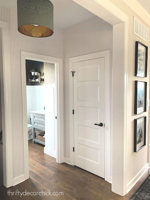 blue and white pinstripe wallpaper foyer