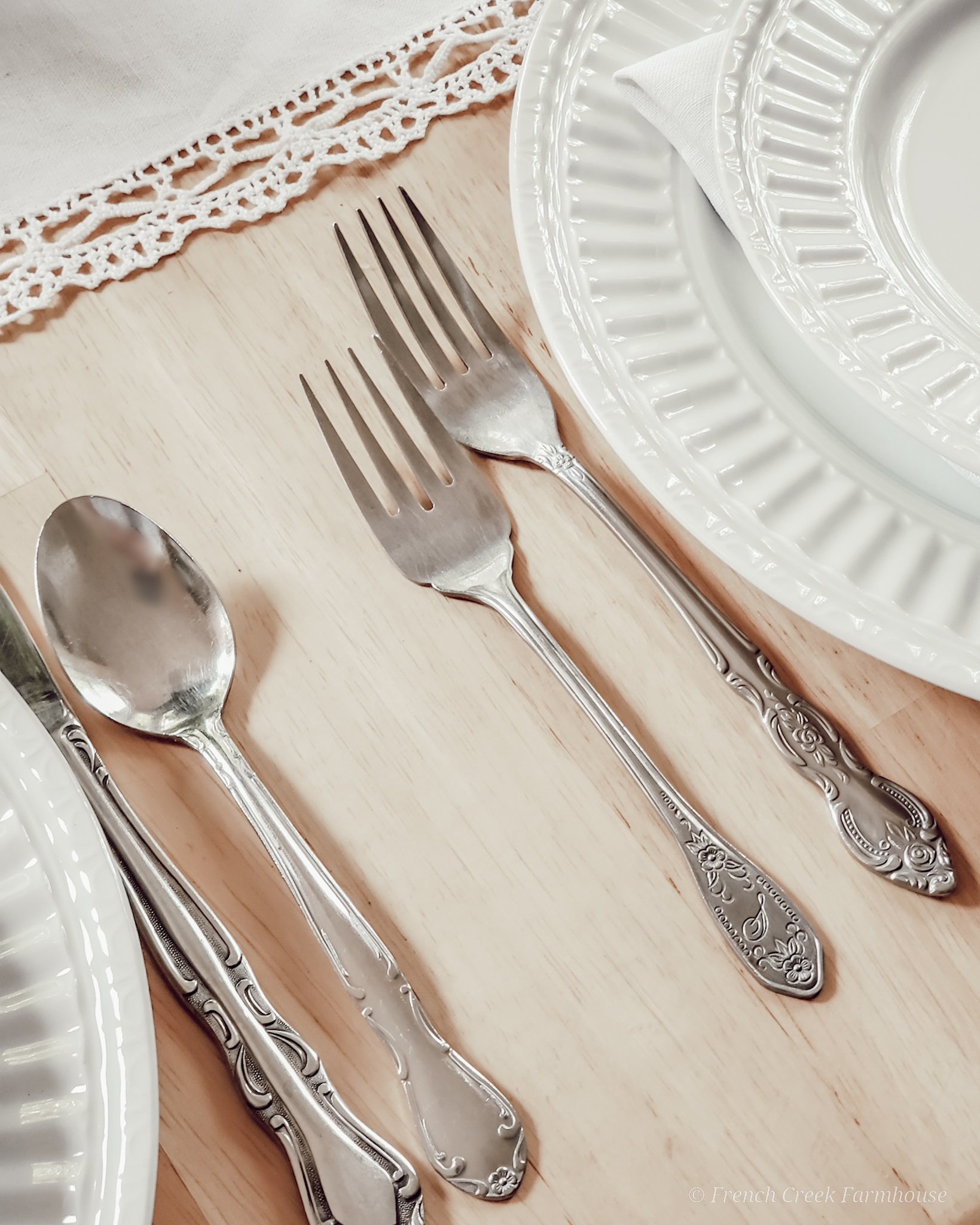 Mismatched vintage flatware is perfect for farmhouse tablescapes