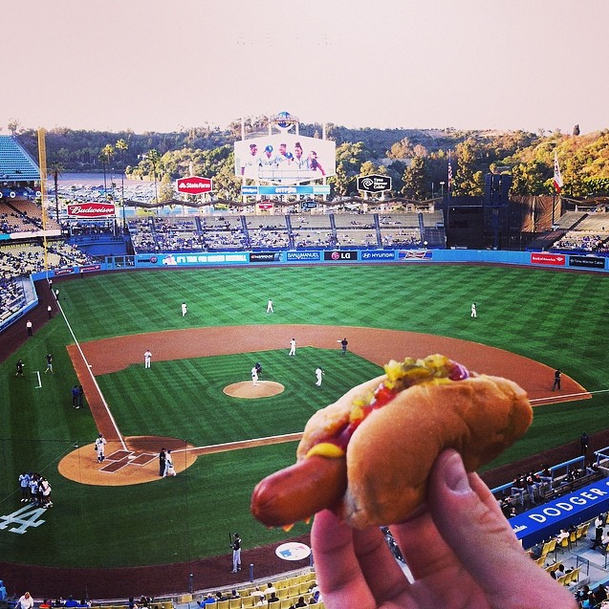 "Enjoying a Dodger dog in LA. - This Couple Said ""I Do"" To A Round The World Adventure."