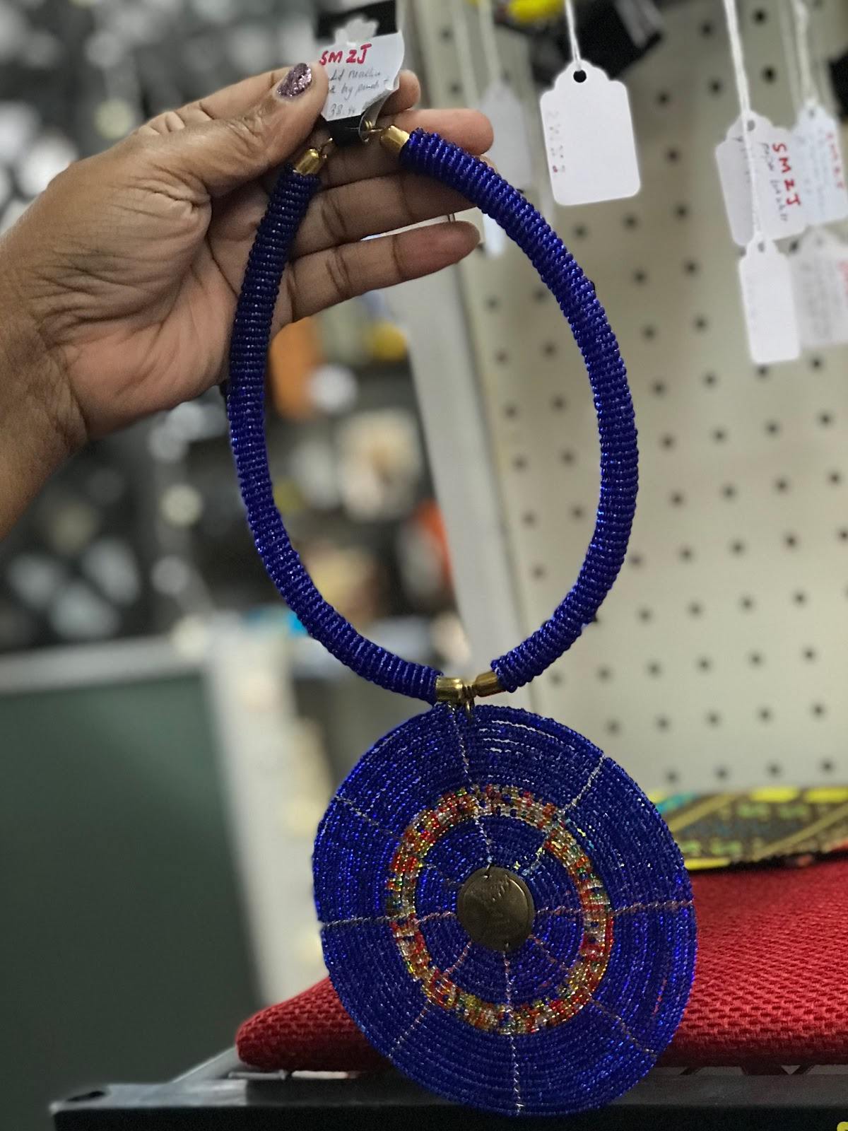 Image: Bold Blue necklace that Tangie will be using to spice up her new wardrobe. Spice And Color On Color On Color!