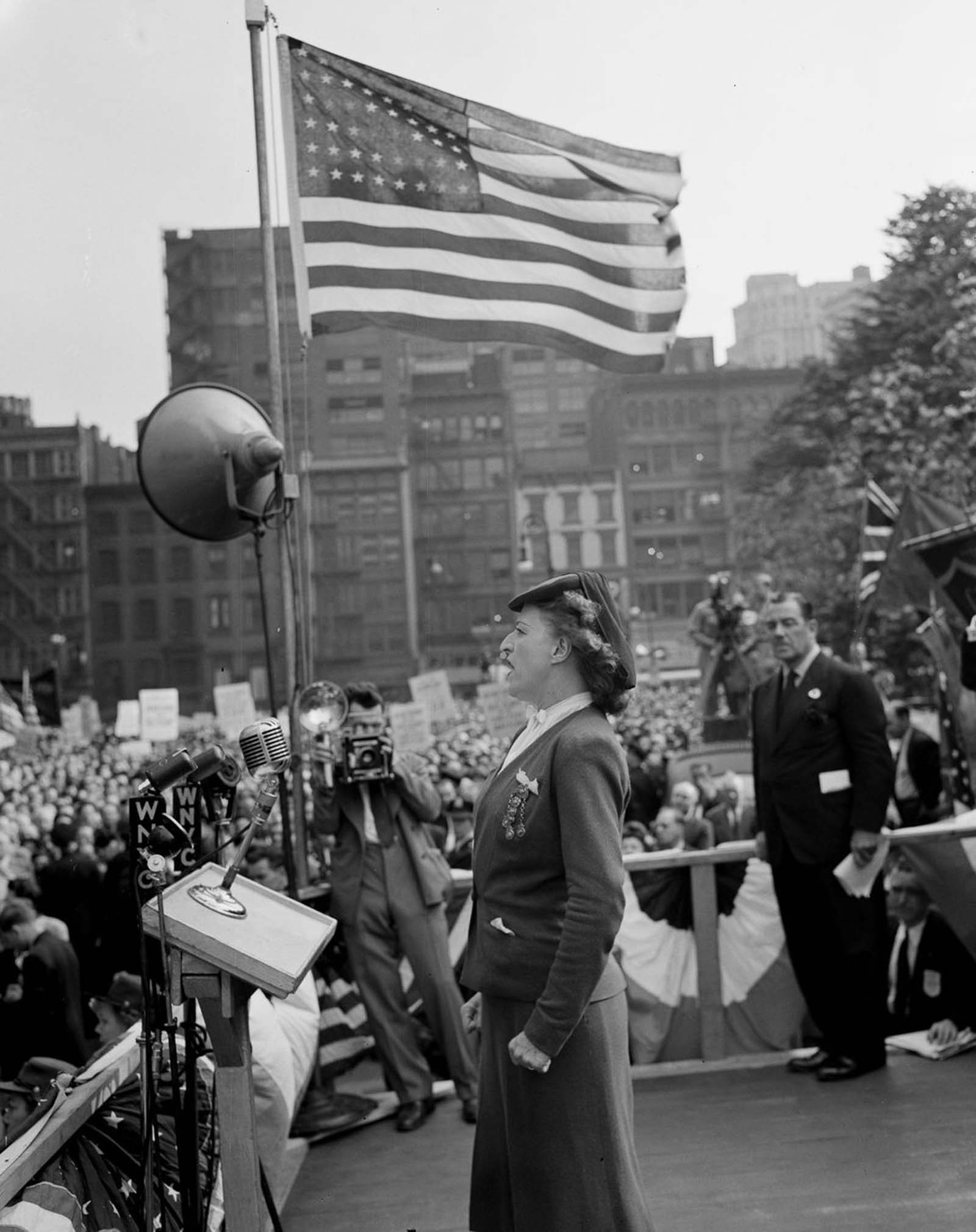 A speaker addresses the crowds in Madison Square.