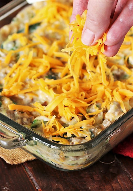 Topping Cheesy Zucchini & Sausage Casserole with Shredded Cheese Image