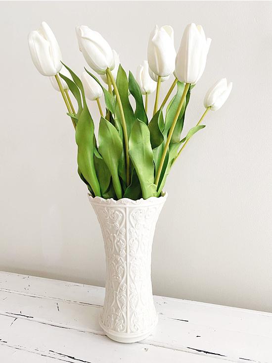 white tulips in white vase