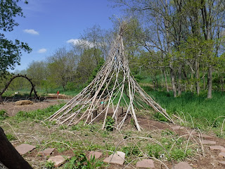 a stick tipi provides a bit of shelter in the Children's Garden at Lauritzen Gardens