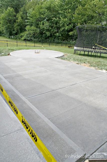 long concrete patio with fire pit area