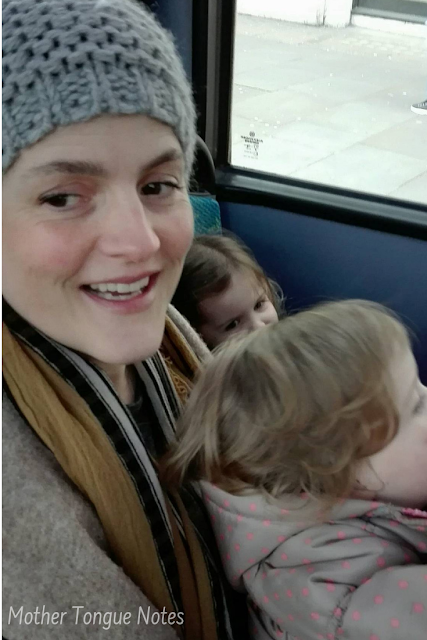 Stories From Life Abroad: Guest Post Series Featuring Mother Tongue Notes - Image Shows A Mum With Her Two Small Children On A Bus