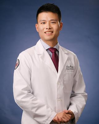 Alan Wang in White Coat