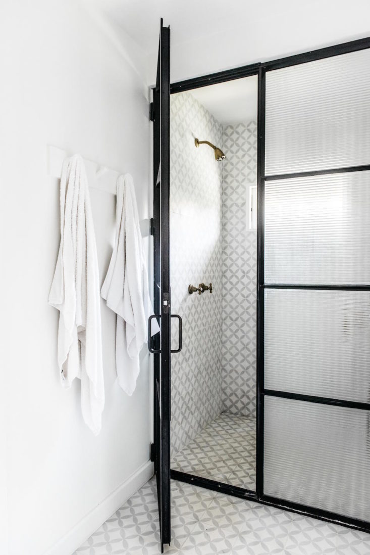 Black steel shower doors in bathroom of beautiful oceanfront cottage on Maui - found on Hello Lovely Studio
