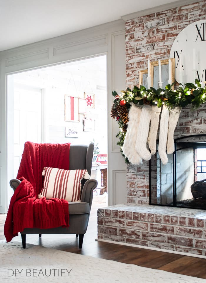 red white and gold Christmas mantel