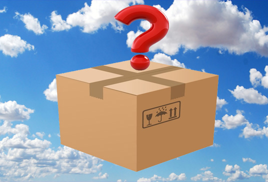 A closed box with a red question mark on top with the blue sky as its background