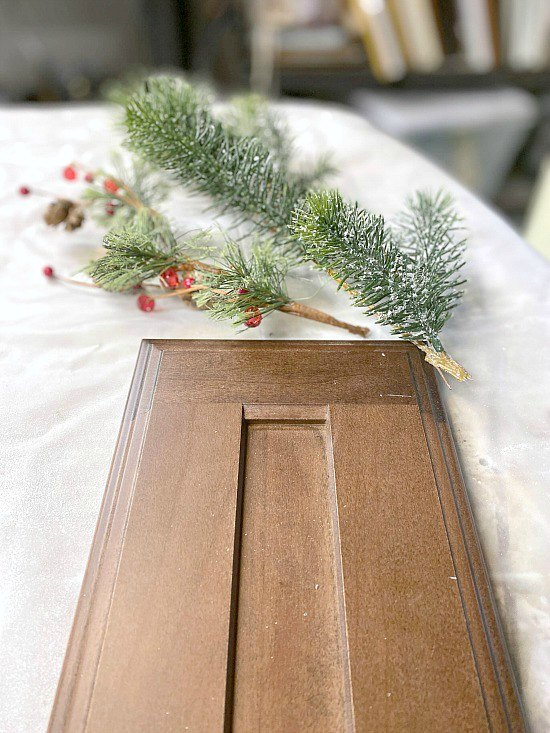 Cabinet door and supplies for a wreath