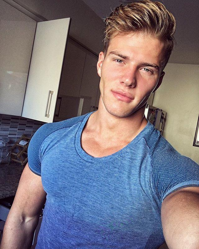 cute-blond-male-model-blue-eyes-muscle-tshirt-fake-lips-injections-beautiful-new-hairstyle-for-men