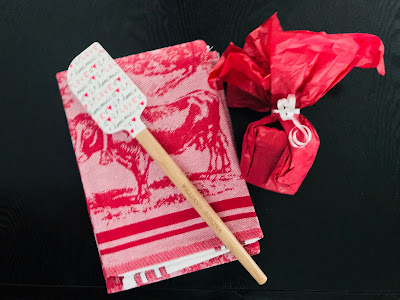Photo of red dish towel, spatula and homemade jam