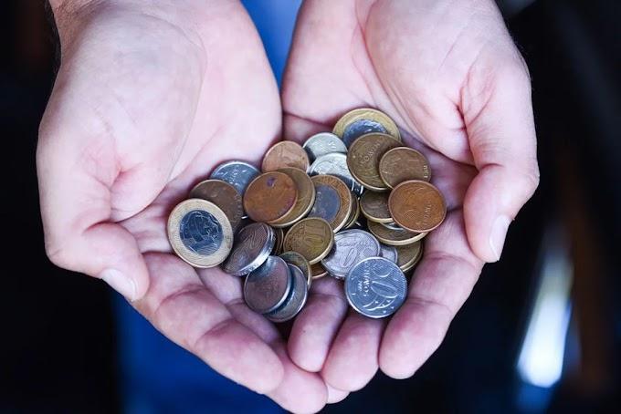 O VALOR DE UMA MOEDA - Você saberia determinar o valor de uma moeda?