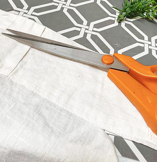 cutting white curtain fabric