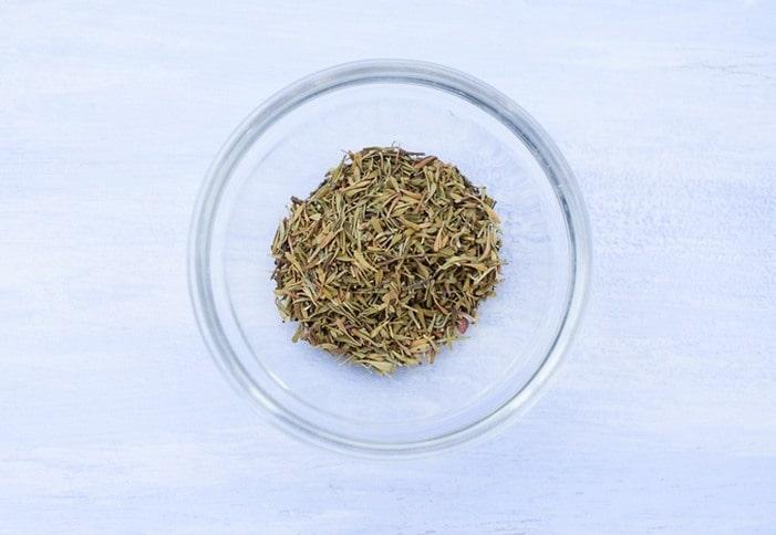 dried thyme in small glass bowl